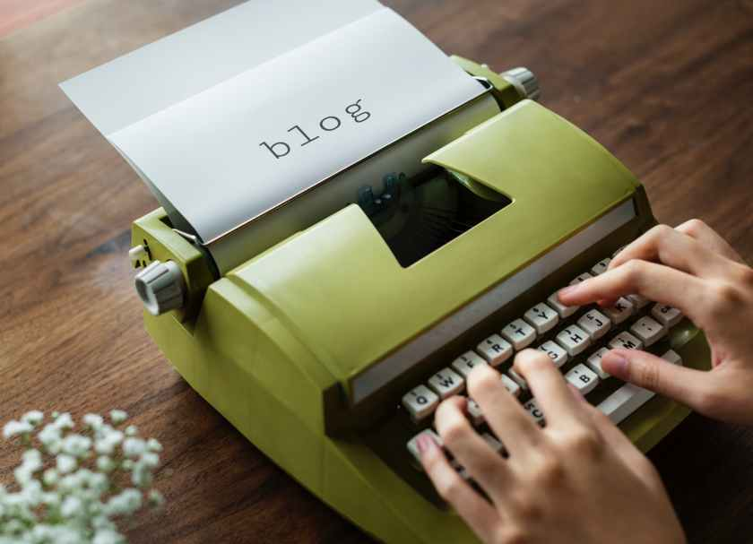 green typewriter written blog